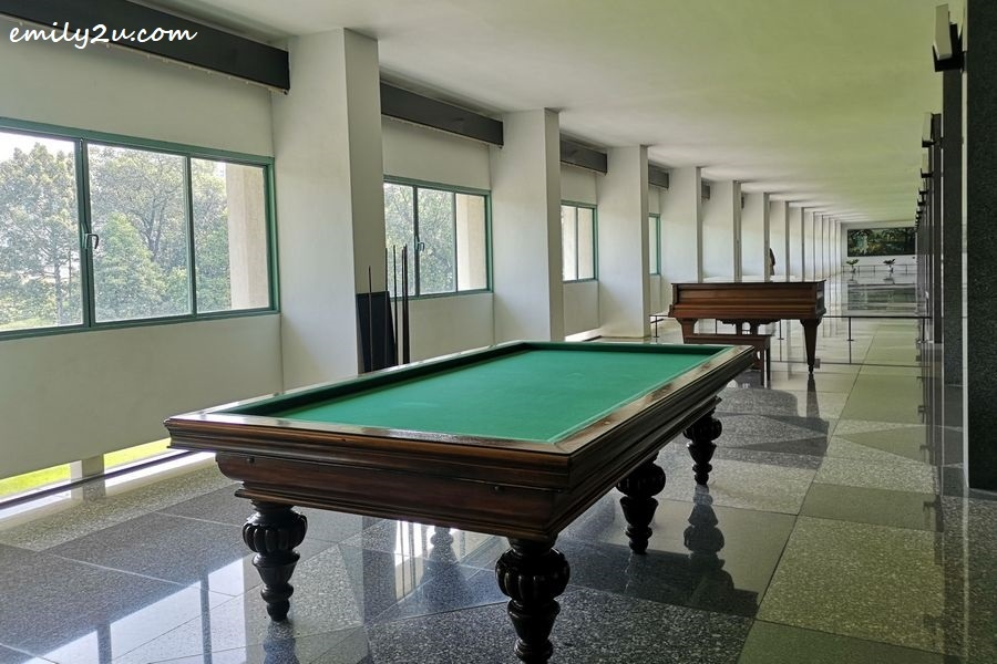 billiards table and grand piano