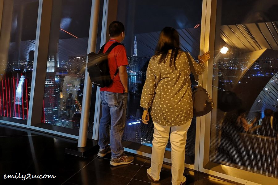 two tourists admire Landmark 81, Vietnam's tallest building