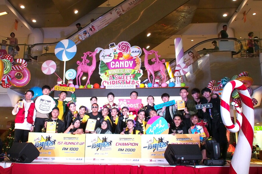 A group shot of winners for #1Min2Fame 2019. Together with the winners are Guest Performers RJVN Dance Crew; Directory Manager for Perak Boost Peter Wong Chee Kuan (6th from left in 3rd row). Winners (from left in front row) are First Runner-Up Peter Au Young; Champion PKAS; Second Runner-Up Flirtatious.