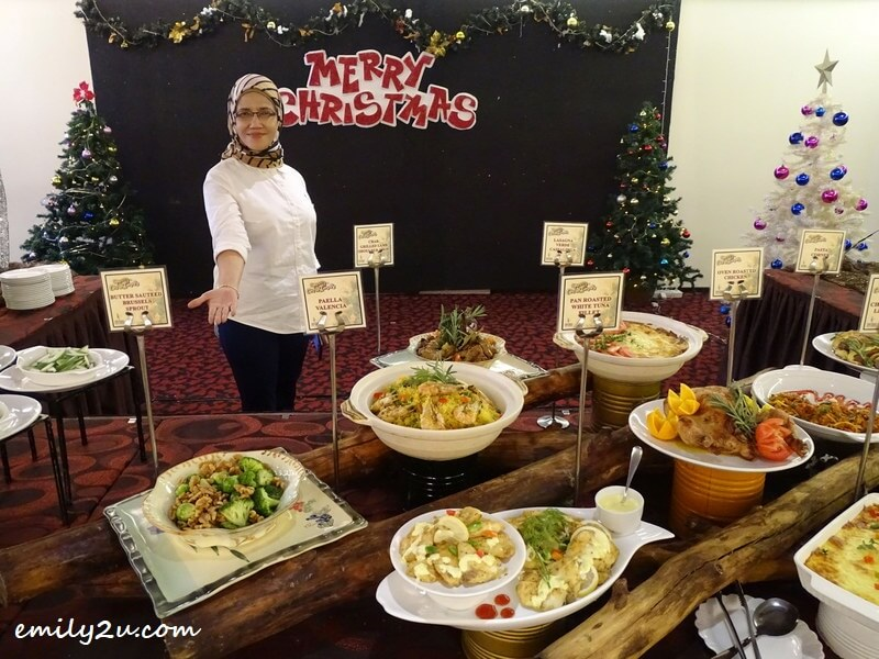 Manager Mariana Abdul Hamid presents Christmas Eve buffet spread at Tower Regency Hotel