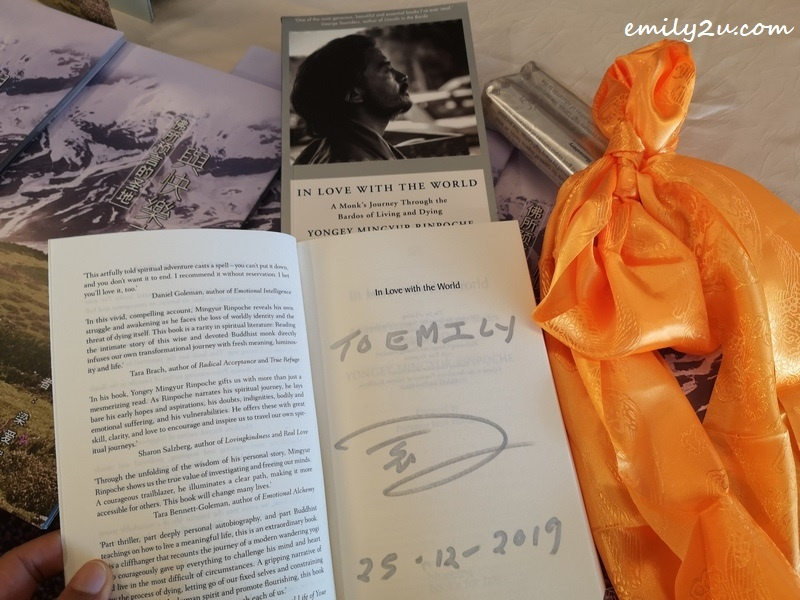 my autographed copy of In Love with the World: A Monk's Journey Through the Bardos of Living and Dying (by Yongey Mingyur Rinpoche)