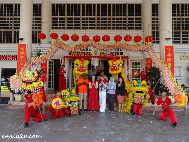 management and staff of Syeun Hotel Ipoh pose with the dragon and lions