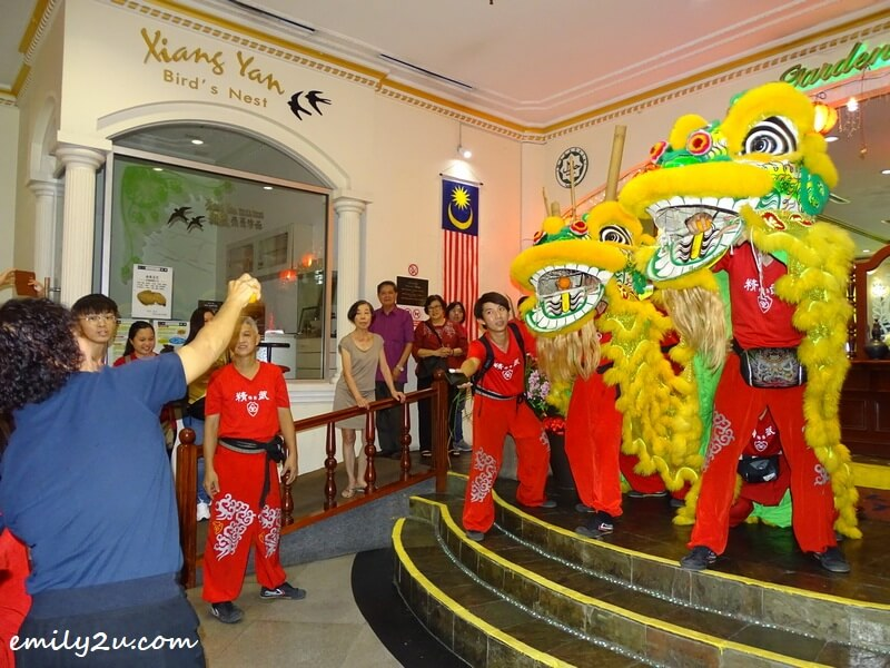 the lions share blessings with well-wishers by tossing mandarin oranges