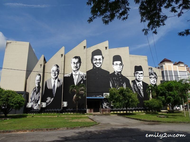 mural portraits of Malaysia's seven prime ministers on the side wall of Dewan Tunku Abdul Rahman