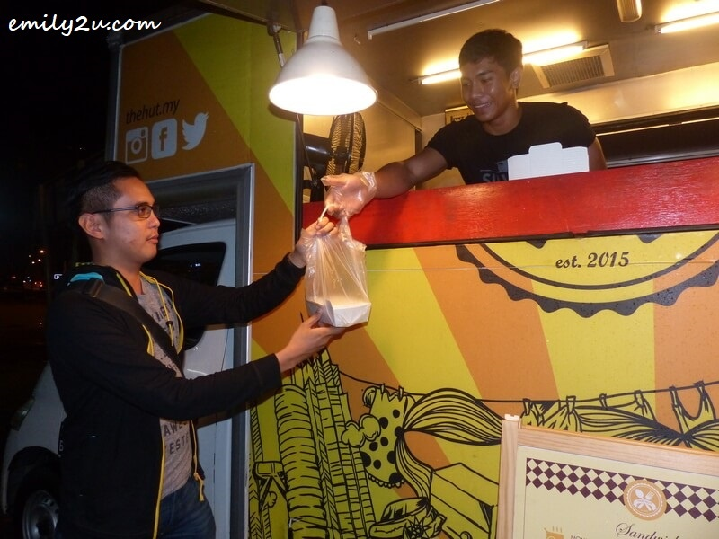 making a purchase from one of the food trucks in Ipoh