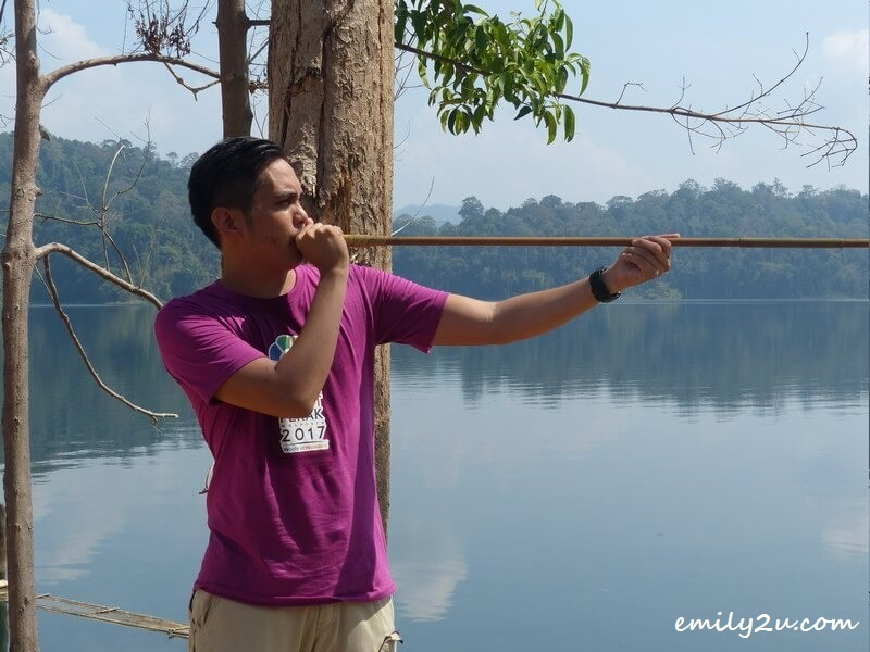 trying out the blowpipe at Kampung Aman Damai, Royal Belum