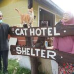 Dr Taq parents in front of Cat Hotel