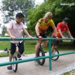 mother and son pair learning to ride the unicycle
