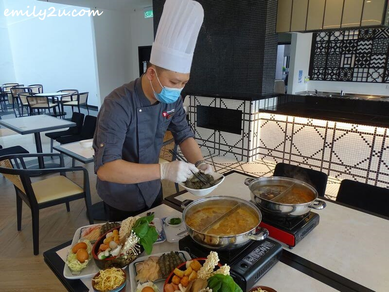 Executive Chef Chong Lih Chyi personally prepares the steamboat