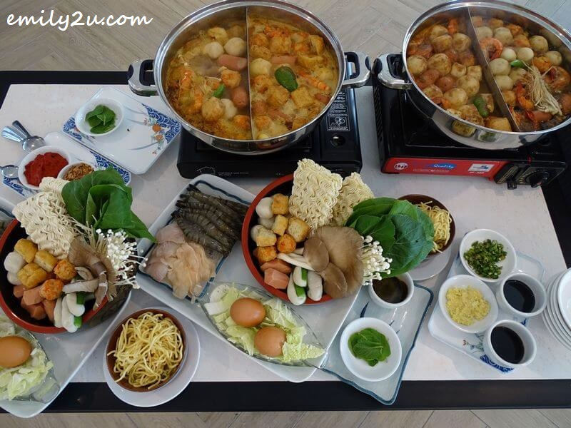 steamboat in action with choice of four soup bases: Penang White Curry, Penang Hokkien, Laksa & Chick Kut Teh