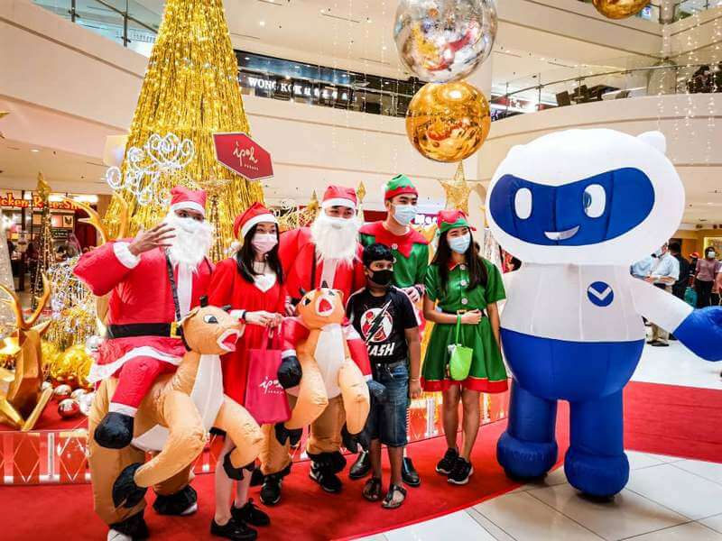 Shoppers take photos with Santas and Santarinas as well as Christmas mascots during the festive celebration at Ipoh Parade.
