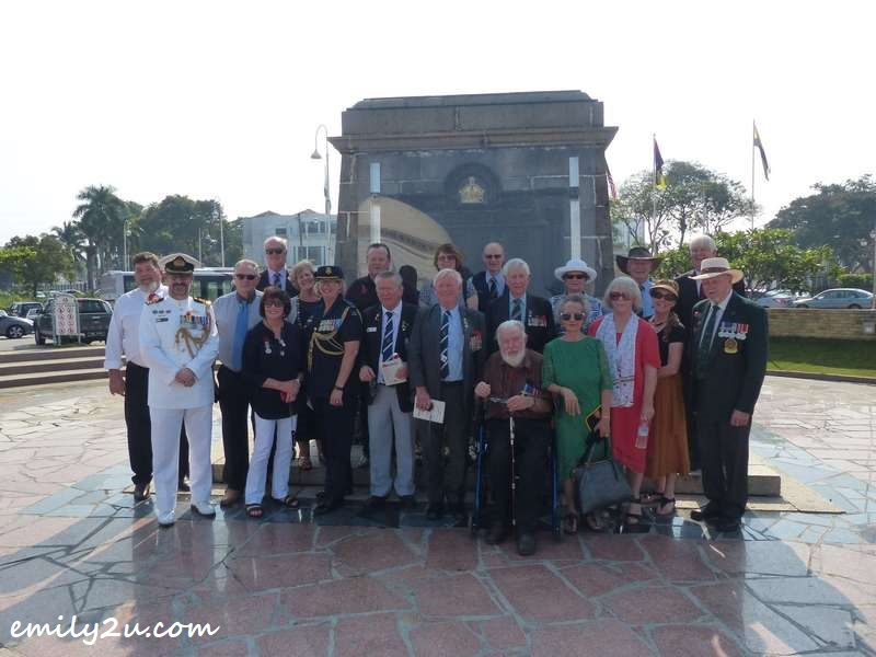 Ken McNeill (back row) & Fred Simpson (front row first from right) with the Australian delegation in front of Ipoh Cenotaph War Memorial