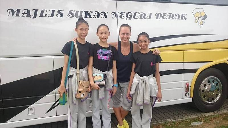 Logunova with her three gymnasts who gained spots in the national squad