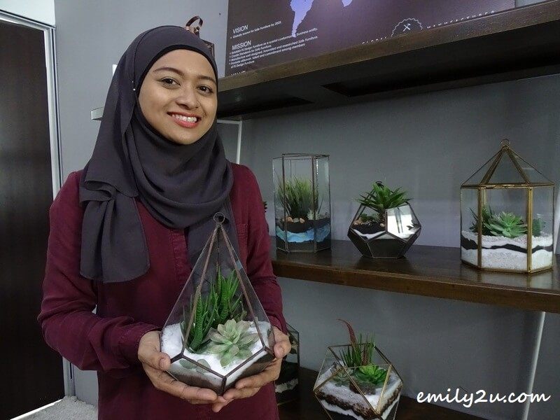 wife Ilmi Shukri Khodori with their product, terrarium