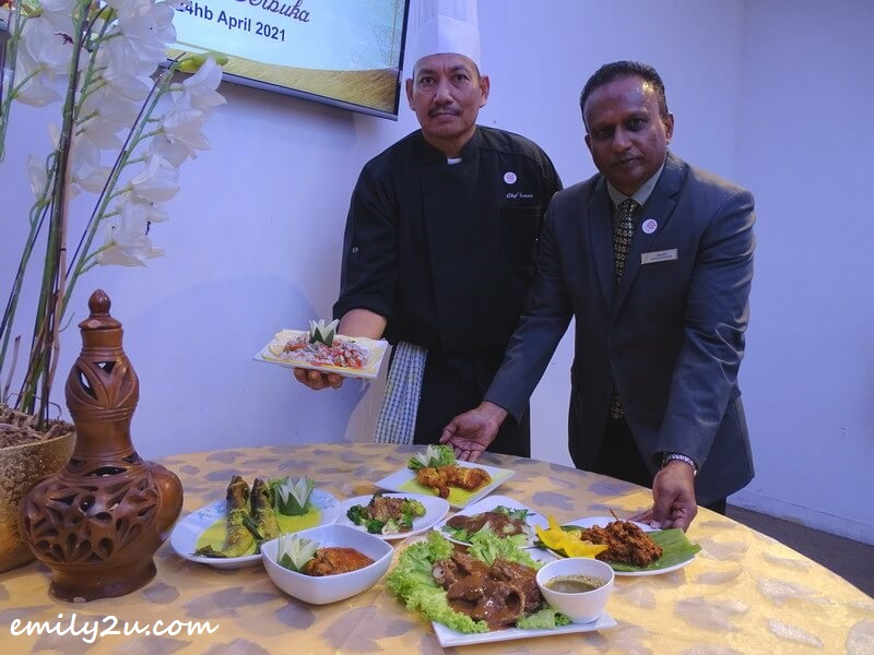 Hotel Excelsior Ipoh's Operation Manager Mr T Rajah (R) and Malay Cuisine Chef, Chef Azman Bin Rizal Azizi (L) introduce some of the signature items on their Ramadan buffet menu